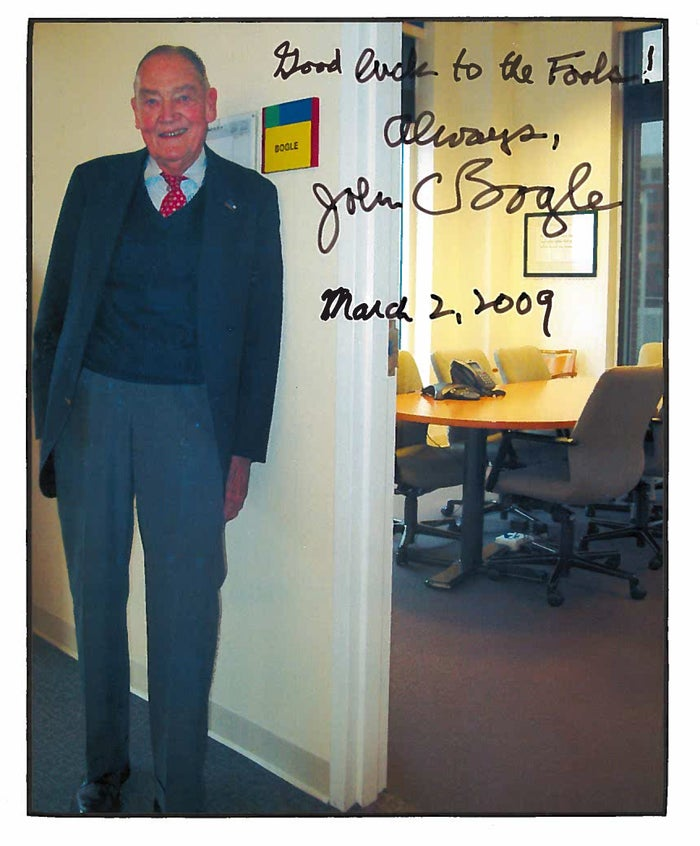 Jack Bogle standing outside The Motley Fool conference room named for him.