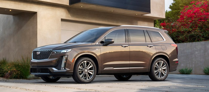A brown 2020 Cadillac XT6 in Premium Luxury trim. It has smaller wheels and subtler styling cues than the Sport version pictured above.
