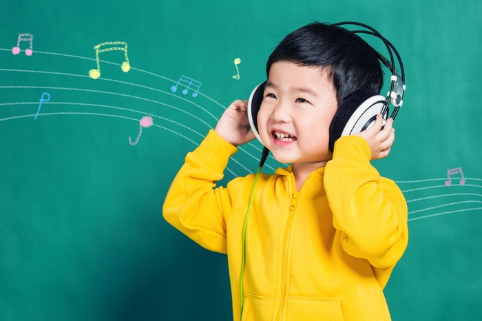 Chinese boy listening to music on headphones