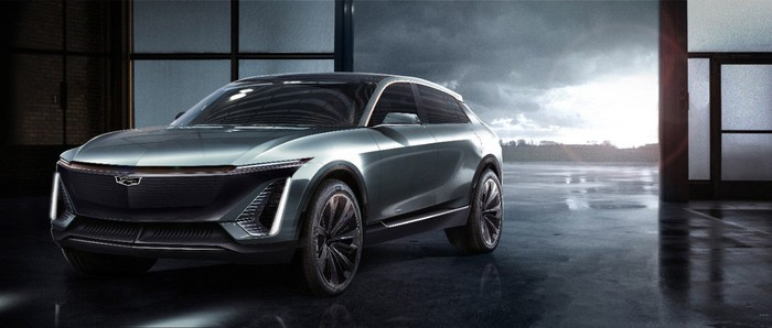 A futuristic gray midsize Cadillac crossover SUV is shown in a three-quarter view.