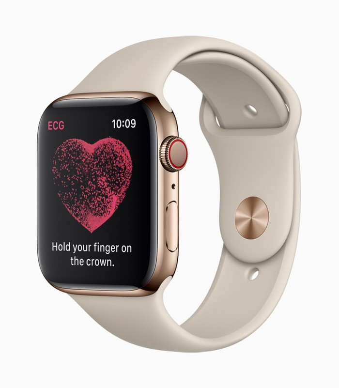 An Apple Watch displaying a heart icon and instructing the wearer to hold their finger on the crown.