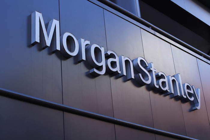 Morgan Stanley logo on a paneled wall background.