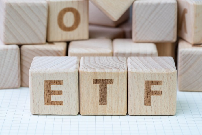 Wooden blocks spelling out ETF