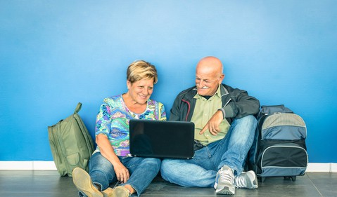 senior couple happy backpacks and laptop
