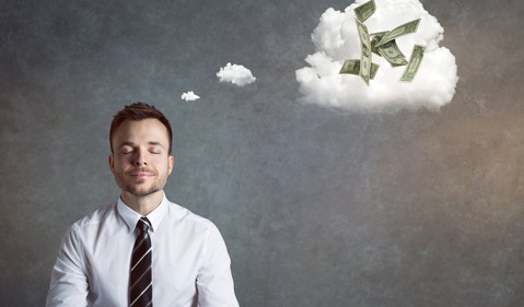 Man with eyes closed and a light smile. A thought bubble is depicting a couple of dollar bills.