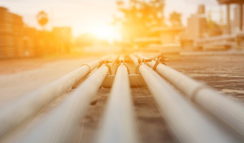 A burst of sunlight shining on a pipeline.
