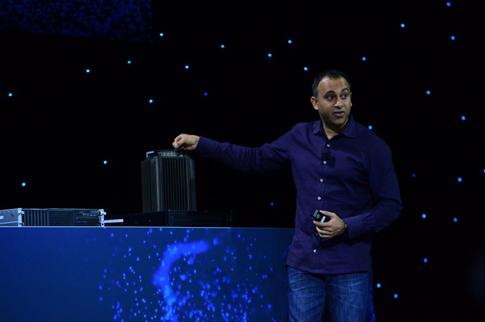 Intel data center chief with a 5G base station on stage.