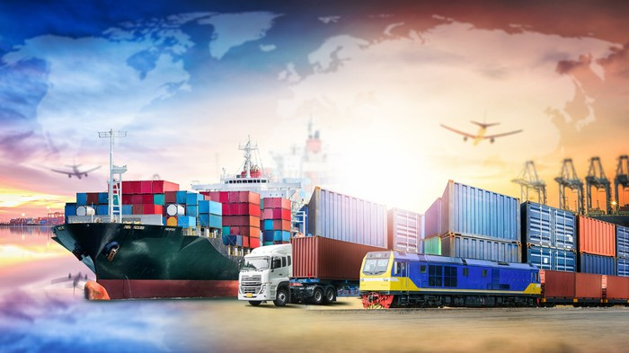 A container terminal, train, airplane, and 18-wheeler with a world map in the background