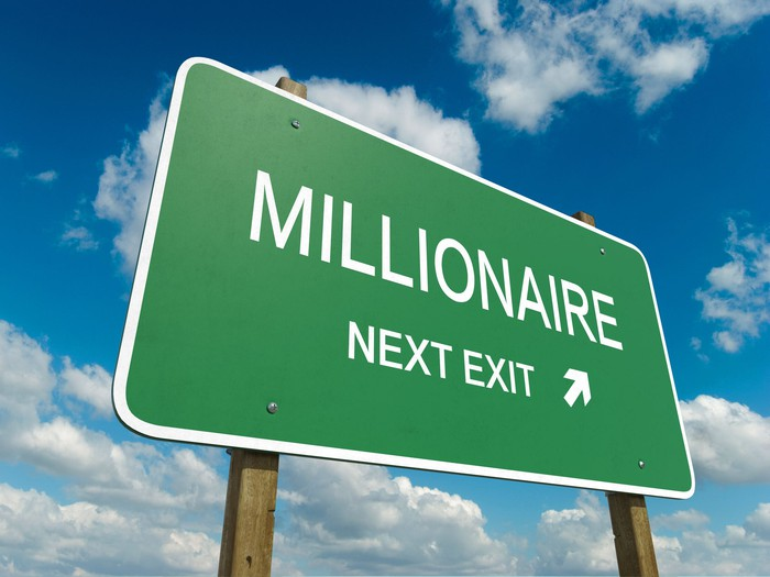 """A road sign is shown, pointing to the next exit, labeled """"Millionaire."""""""