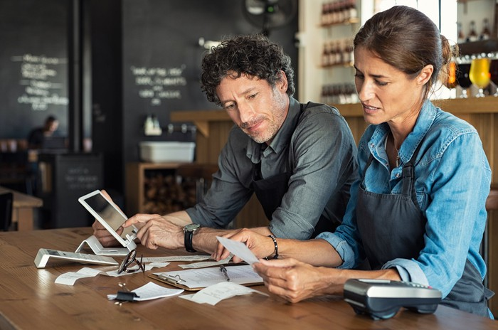 Man and woman going through receipts