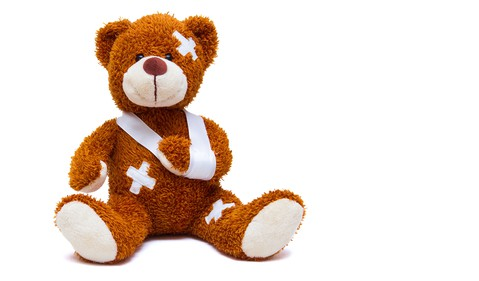 Injured Teddy Bear with sling and bandages GettyImages-589582238