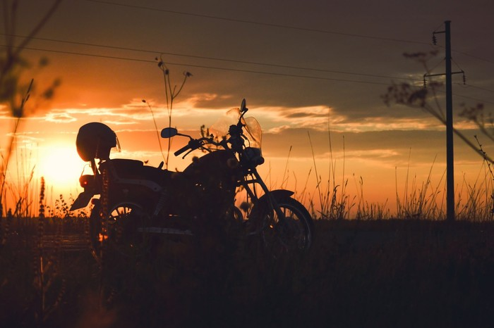 Motorcycle in silhouette at sunset