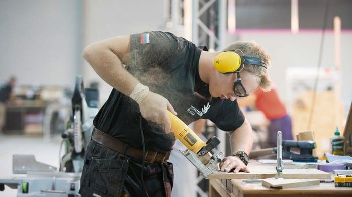 A man using a Stanley Black & Decker tool.