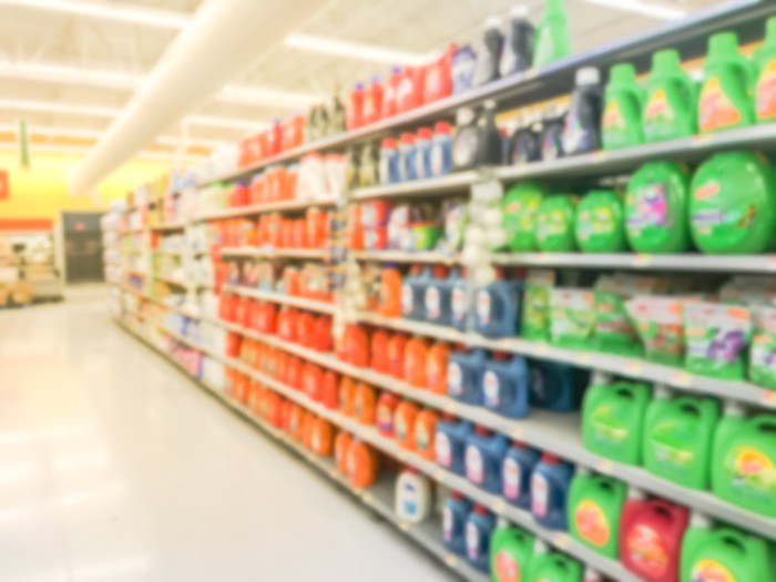 A blurred image of a grocery aisle