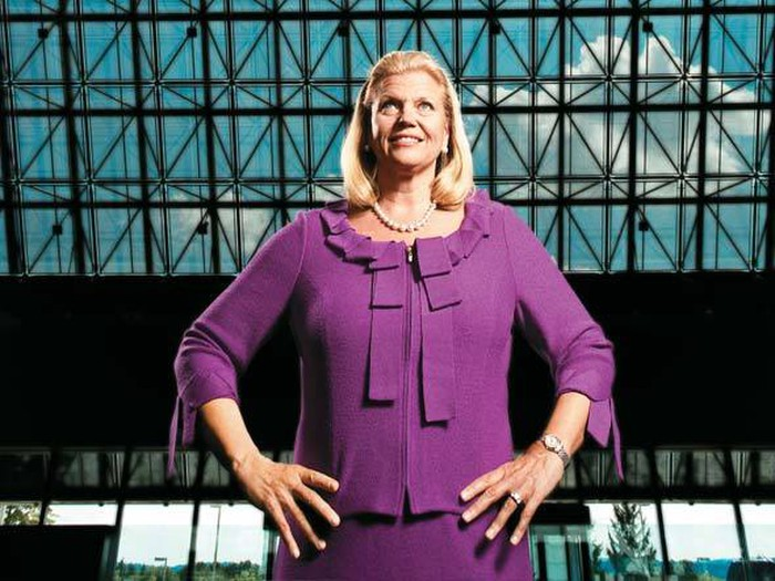 IBM's CEO, Ginni Rometty, smiling with arms akimbo in a purple dress.