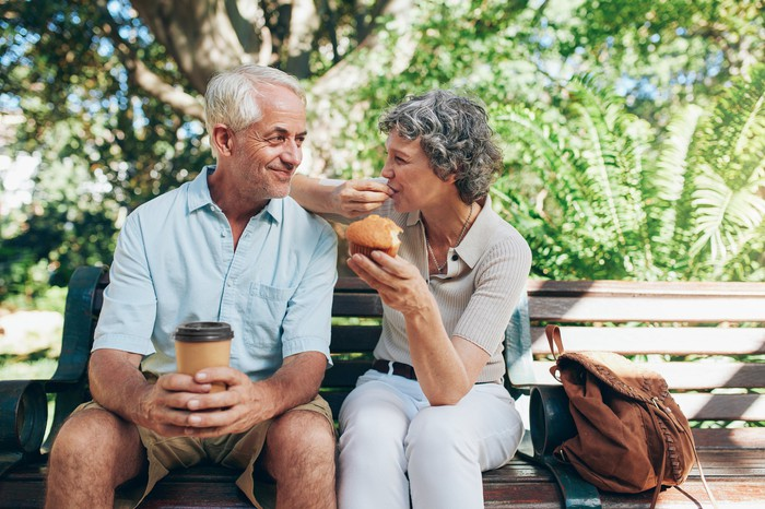 Senior man and woman on a park bench