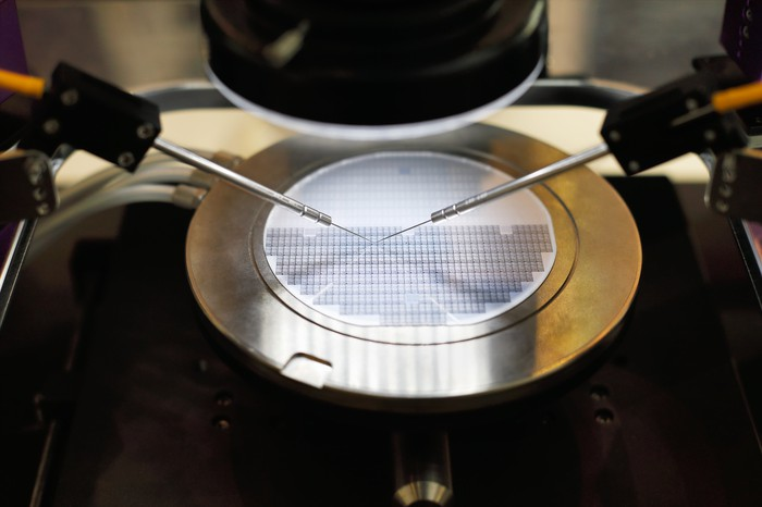 An image of a silicon wafer undergoing probe testing