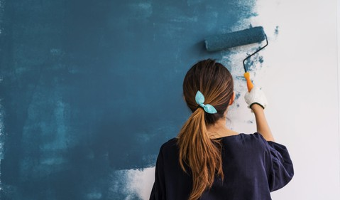 home improvement woman painting a wall