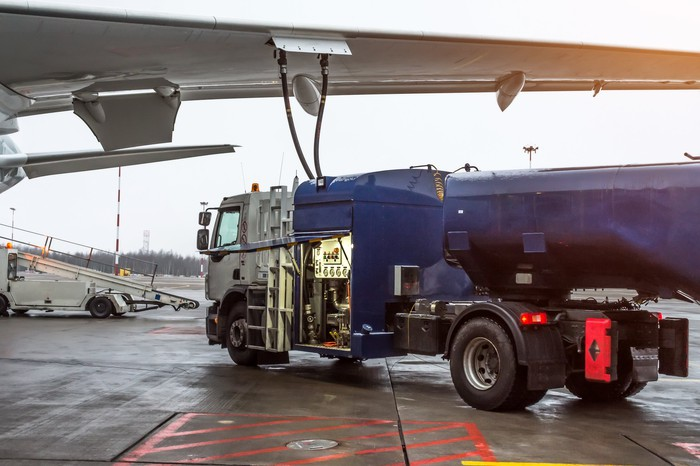 Tanker truck fueling an airplane