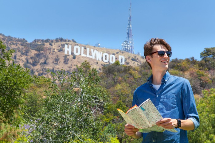 Tourist with the Hollywood sign in the background