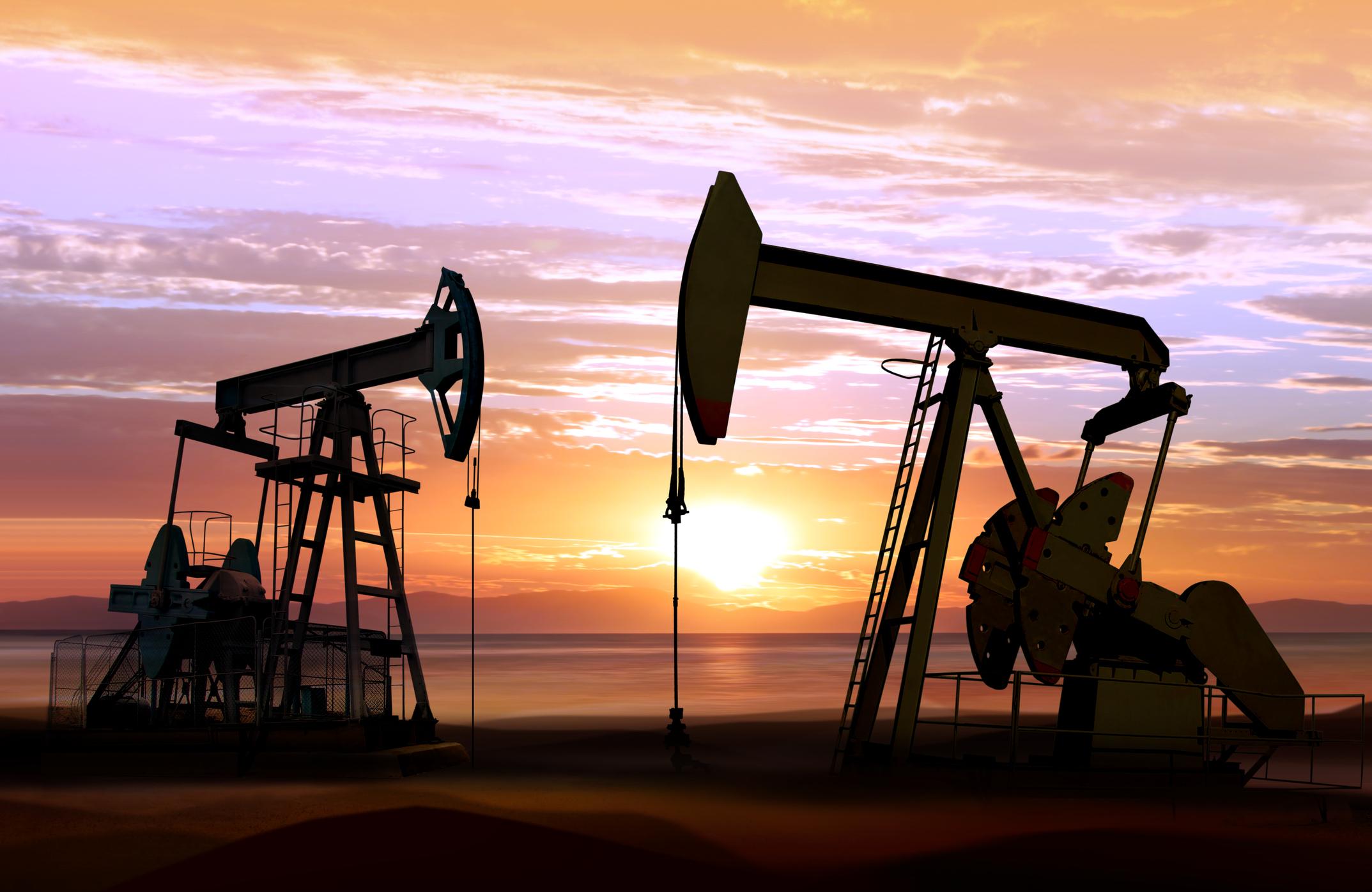 Oil pumpjacks operating at sunset.