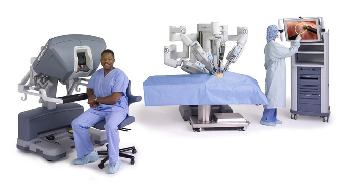 Da Vinci robotic surgical system with a physician at the console.