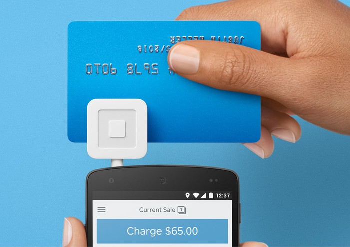 Card being swiped through Square reader