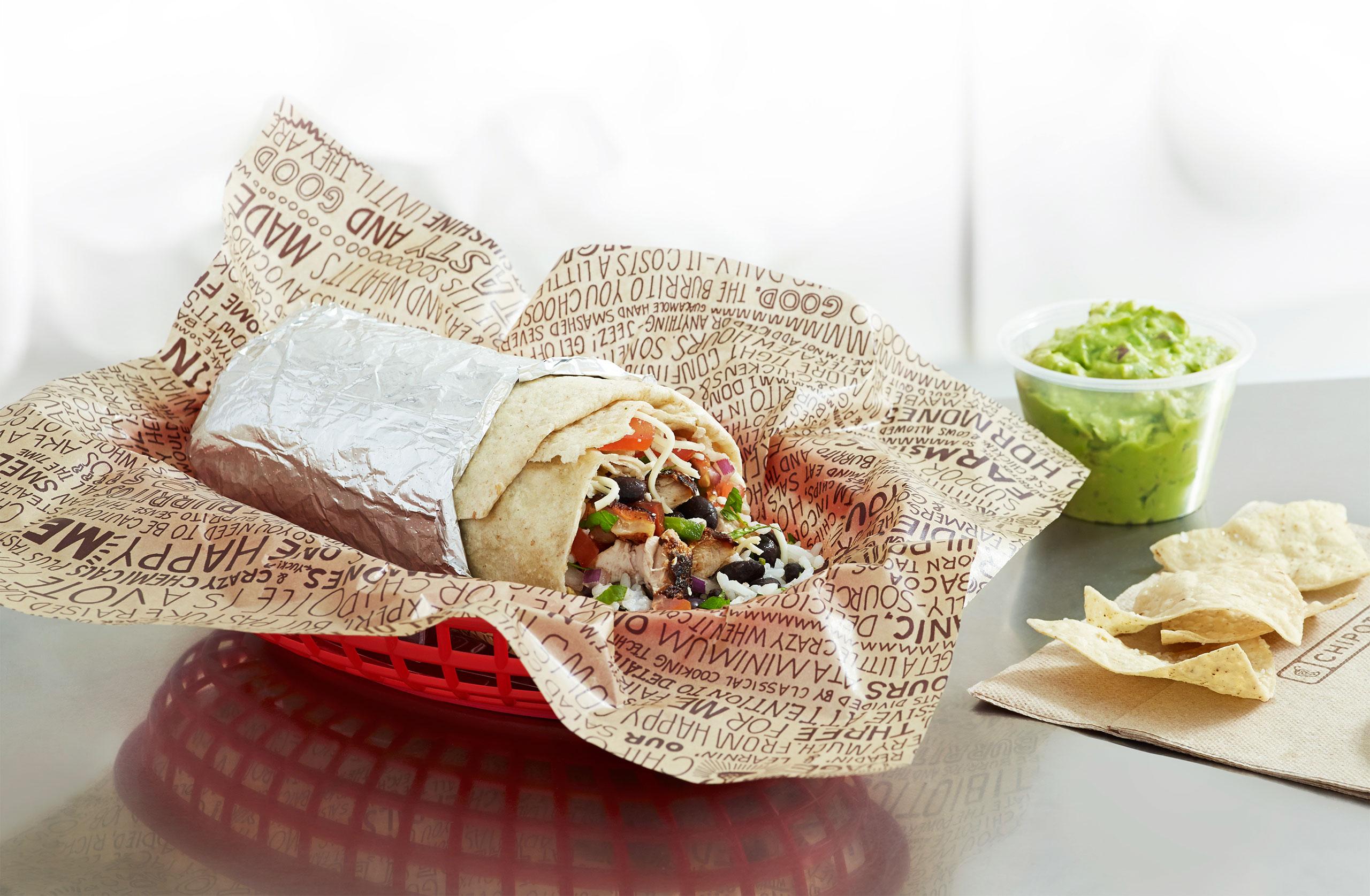 A Chipotle burrito in signature tinfoil wrapper.