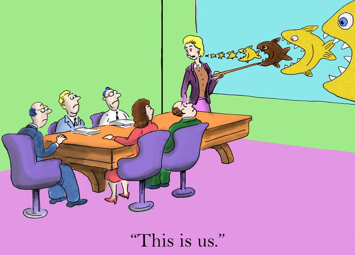 "A cartoon images of a businesswoman in a boardroom meeting. The woman points to a drawing of several fish of different sizes, each one about to get eaten by a larger one. ""This is us,"" she says, indicating a mid-sized fish in the middle of the chain."