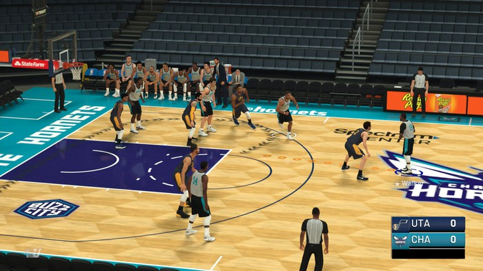 A screenshot of game play in NBA 2K19 with players on a basketball court.