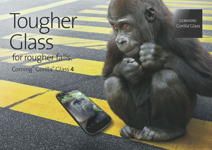 Gorilla looking at smartphone with gorilla face on it.