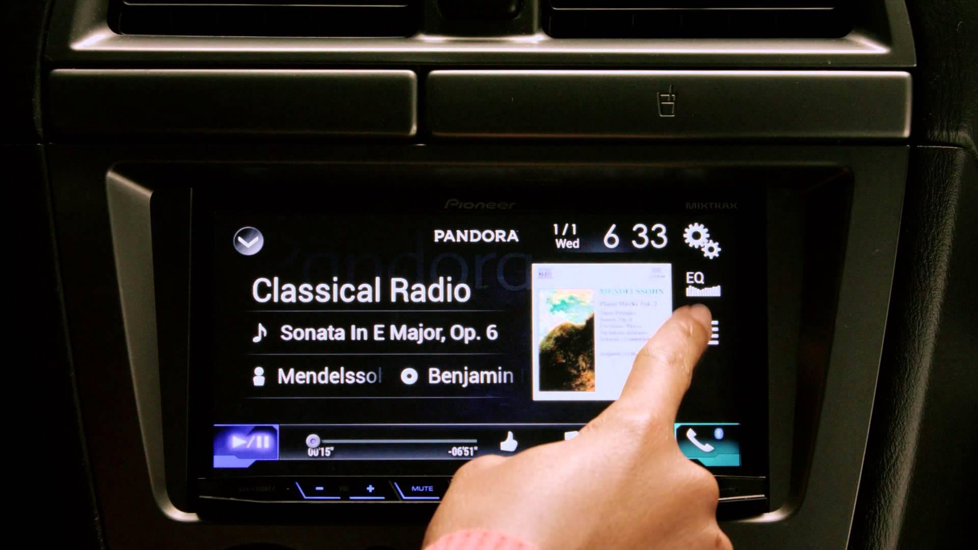 Pandora app streaming on a dashboard touchscreen.