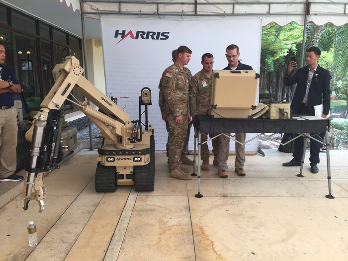 Harris officials demonstrate an explosives disposal system