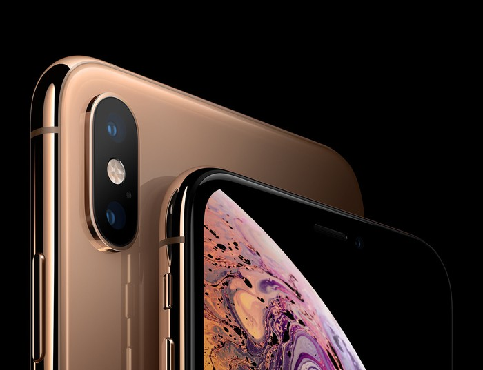 A rose-gold iPhone XS from the front and back.