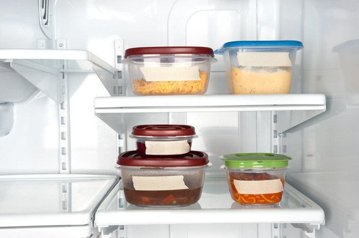 A set of Tupperware containers in a refrigerator.