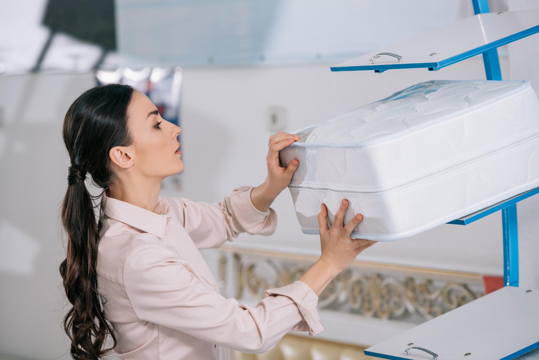 Woman shopping for mattress