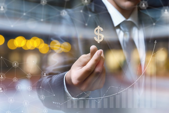 Man with a dollar sign hovering above his hand, superimposed on rising graph.