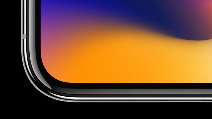 A bottom corner of an iPhone X, showing the screen going all the way to the edge of the device