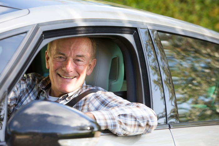 Older man in driver seat of car