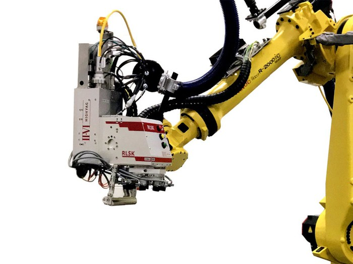 Yellow robotic arm with a laser mounting at the end with the II-VI logo.