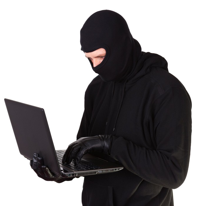 Criminal with laptop in hands