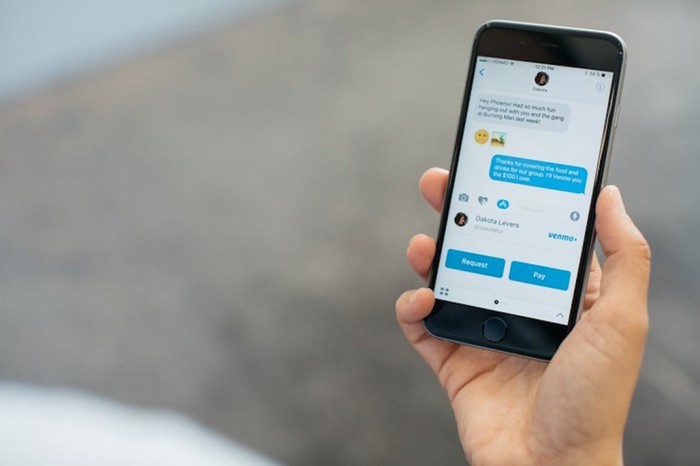 A person using Venmo messaging on a smartphone.