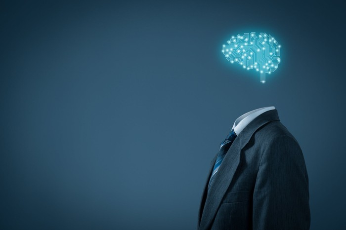 An artist's rendering of a brain made of lights sits atop a man's suit that is upright, as if filled by a body.
