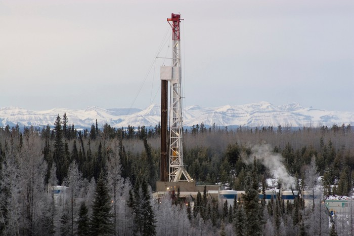 Drilling rig at work in winter,