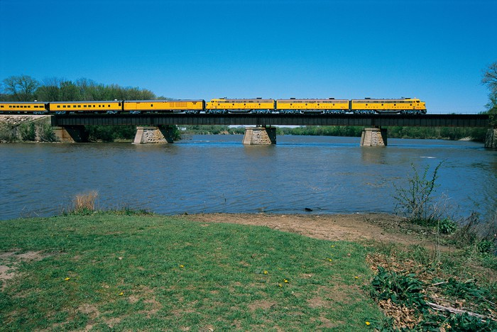 A Union Pacific train on a bridge across a river.