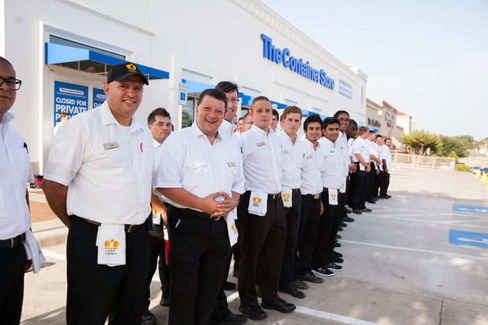 A line-up of employees outside for a new Container Store opening.