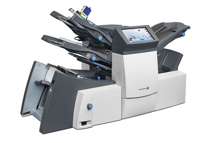 Large office machine for copying/collating, with Pitney Bowes logo on it.