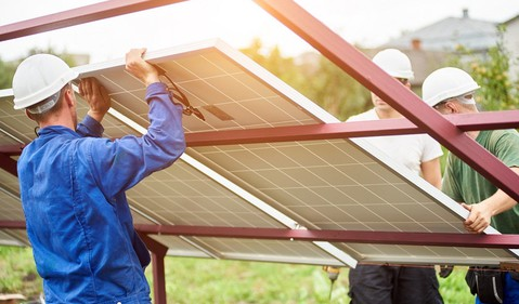 Solar panel installers at utility project