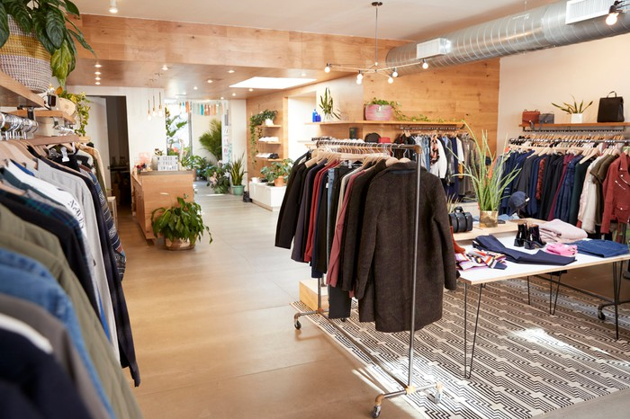 Men's jackets on racks in an upscale clothing store