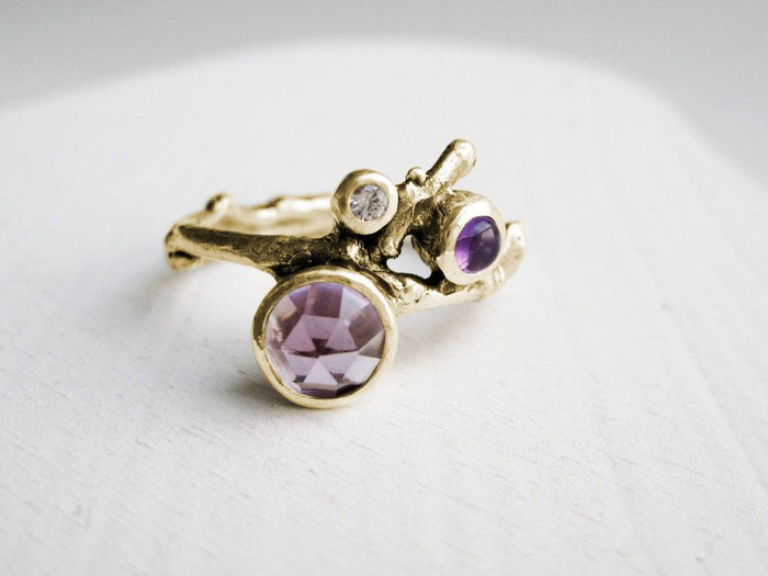 An amethyst ring on a white background.